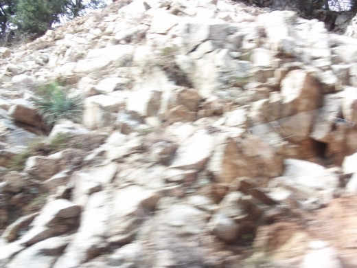 Rock slides happen on the Rim of the World Highway, and netting is used in places to keep these from rolling down on to the road.