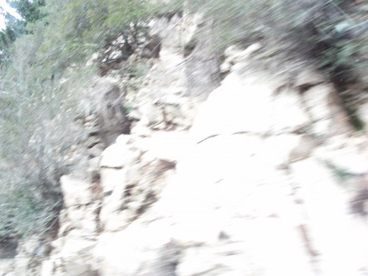 Rocks on the hillside above.