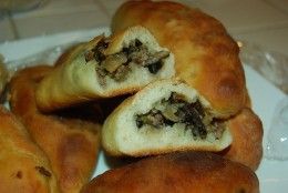 Pirozhkis are filled savory or sweet pastries, and can be made with a yeast bread or pie crust-like dough.