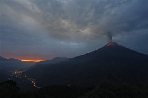 The Tungurahua Volcano spews ashes during an eruption as seen from Cotalo, Ecuador, Friday, April 29, 2011.