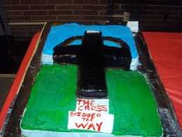 Cake I made for bake off at church the cross is rice crispy candy covered in fondant with brown icing paint