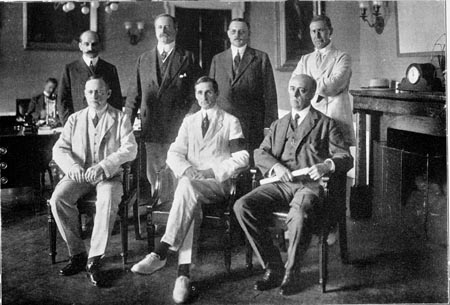 The Federal Reserve Board, 1914, l-r standing: Paul M. Warburg, John S. Williams, W.P. G. Harding, Adolph C. Miller; Seated: Charles S. Hamlin, William G. McAdoo and Frederick A. McAdoo,