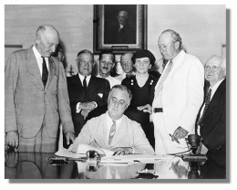 President Franklin D. Roosevelt, signing Social Security Act of 1935 in the Cabinet Room of theWhite House on August 14.. Library of Congress photo.