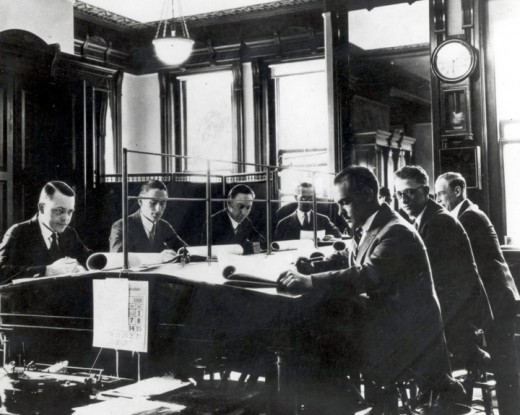 The NOAA team hard at work... in the early 20th century.