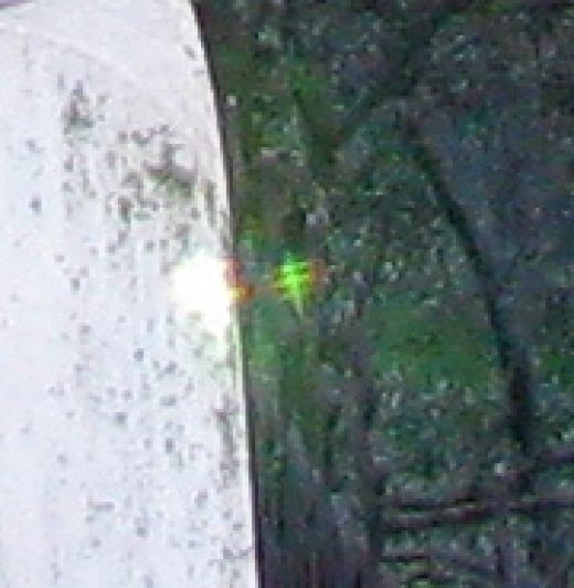 Close up of second photograph, taken seconds after the first.  This time only one Elemental appears.  The tiny light is lower and closer to the monument and you can see it's glow on the opposite side of the monument as the sun.