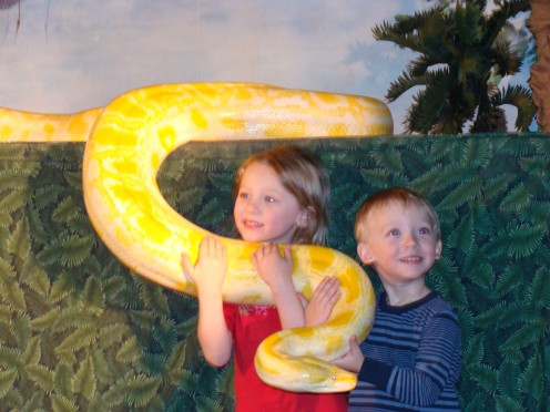 Yes, it is a real python that they are holding.  No fear here!