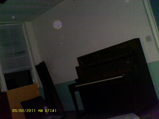 Look At The Orbs In This Photo. One Large One Is Clearly Visible At The Top Left Portion Of The Photo. These Orbs Were Visible To The Naked Eye And Danced Around The Room.