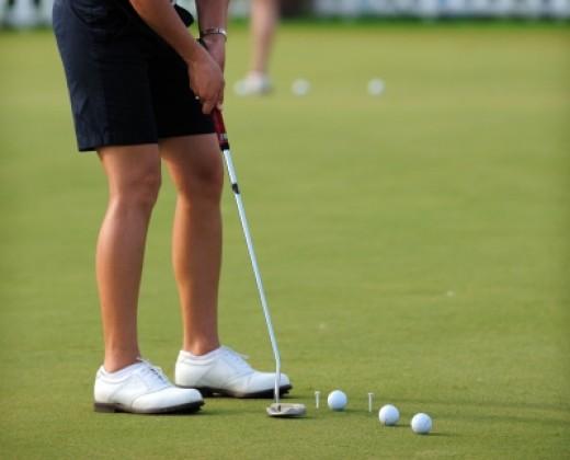 Woman enjoying golfing