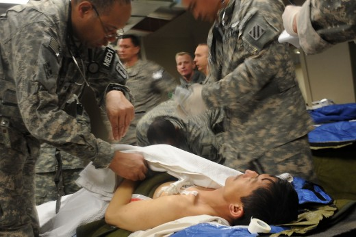 """Army medical personnel treats of one of the survivors of the Salang Pass avalanche at the Triage on the Bagram Airfield in Parwan, Afghanistan, Feb. 9. He along with many other survivors were treated and feed a hot meal as a part of the Afghanistan"