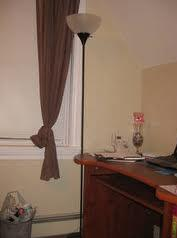 A simple, yet elegant, tall lamp such as this should do the trick.