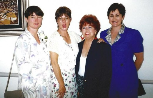 Mom and her daughters late 90's at my son Troy's wedding. From left to right: Myself, my silly sister Jamey, Mom and sister Chris.