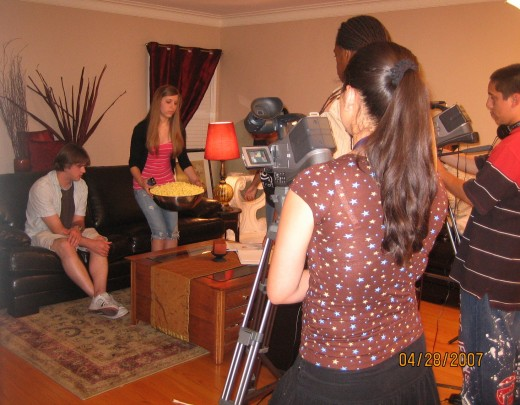 Actors filming a scene for a Time Warner Cable Show.