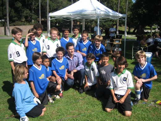 Child actors working with Ioan Gruffudd on a soccer scene for the movie, The TV Set.""