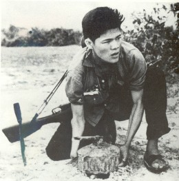 VC preparing a mine for the in coming marines