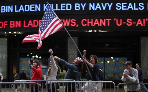 Flag waving crowd of Americans rejoicing at the news of Bin Laden's death.