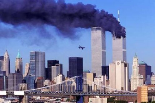 With The First Tower Already Hit and Burning, A Plane Takes Aim At The Second Tower
