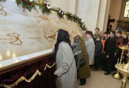 The Turin Shroud - an orderly queue in Lviv, Ukraine, lining up to kiss it on Easter Day. (I don't know what it was doing there... I thought it belonged in Turin)