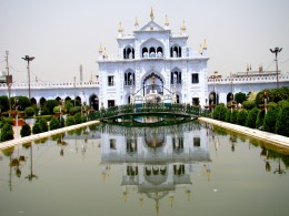 "The reflection of Chhota Imam Bargah in the central water-body as per  the ""Charbag"" style of Mughal architecture"