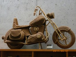 Here is an um image that could be a cargo cult representation by someone who saw a motorcycle but lacked the understanding of its real design and workings. This is a straw woven image of a motorcycle. This was found at the UBC museum of anthropology,