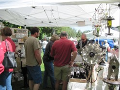 When I arrived, most booths were almost empty. As you can see, Dan's art made of recycled knives, forks, and spoons are very popular. People are actually standing in line to buy, and they just kept coming. His items are in demand. Click to enlarge