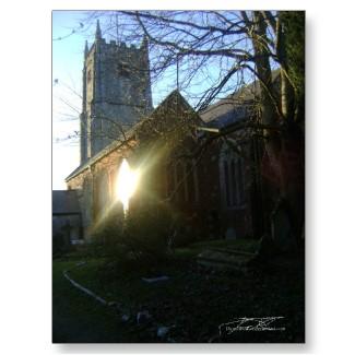 Reflection of sunlight off the Kingsteignton church, Devon, England.