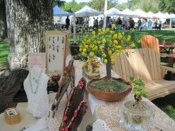 """You see the lemon """"Happiness"""" tree along with some other miniature trees on the top level. Underneath are some of Aileen's jewelry pieces."""