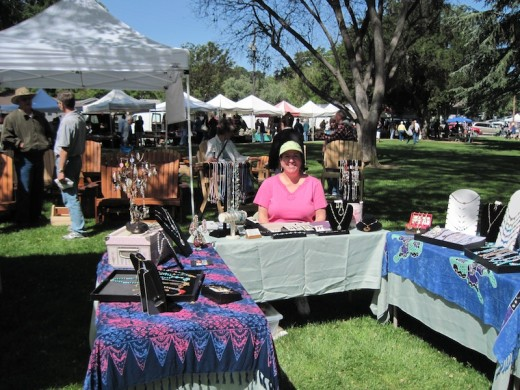 Helene sits at the back of her booth at Day in the Shade, Templeton, CA, May 7, 2011. She is exhibiting her many jewelry designs. For more, see her Etsy store.