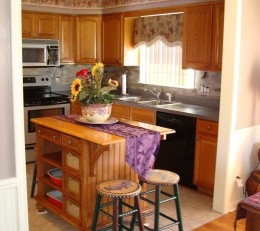 Opening up the kitchen to the dining room can make a big difference in the traffic flow in the rooms.