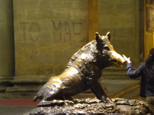 Well worn snout of Il Porcellino in the Mercato Nuovo - Visitors to Il Porcellino put a coin into the gaping boar's jaws with the intent to let it fall through the underlying grating for good luck and rub the boar's snout to ensure a return to Firenz