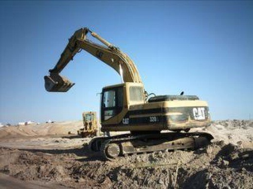 Heavy equipment preparing land for new construction in Rocky Point, Mexico.