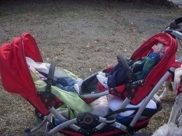 Tandem Stroller With both seats, Summer infant Car Seat Cover being used on stroller seat.