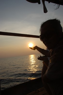 "A photo showing my friend ""plays around with  sunset"" prior to landing to the island."