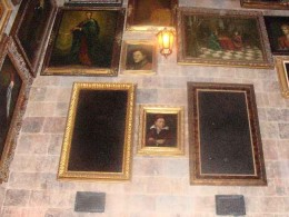 The paintings move.  The camera is unable to capture the images and the result is a dark rectangle.