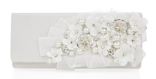 With glass pearl and crystal-embellished floral detailing, Oscar de la Renta's white silk clutch will make a daintily decadent companion to classic bridal looks. Carry this decorative piece with a simple wool-crepe dress and platform pumps