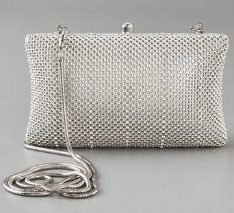 That's even cheap! This structured, textured metal clutch features rhinestone stripes. Rhinestone accent at hinged snap closure. Gunmetal hardware and detachable snake-chain strap. Logo-print lining.