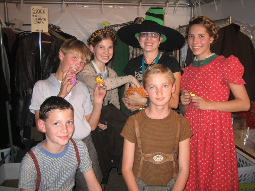 "Child actors with the wardrobe department on the set of, ""The Good German."""