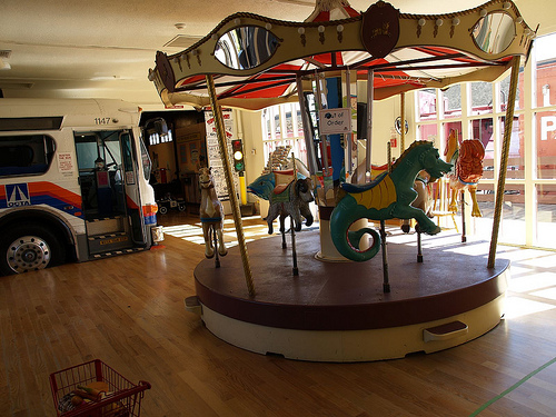 A view of a carousel inside the museum. Small children are welcomed to ride on it.