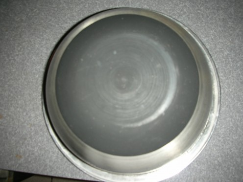 Upturned metal bowl with rubber bottom. Easier for all the whisking.