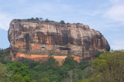 "Sigiriya Rock! The orange color running across the side is actually the ""Mirror Wall"" along which visitors must walk on the way to the top."