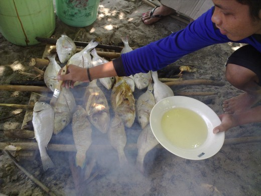 The freshly caught fish are being prepared for our lunch.