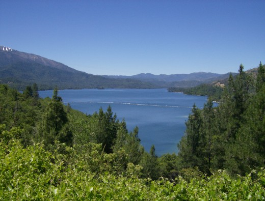 "Whiskeytown Lake, from the visitorscenter. Drive a few miles down the road to our very own ""Brandy Beach"" for a BBQ, complete with sandy beaches and lifeguards for the kids!"