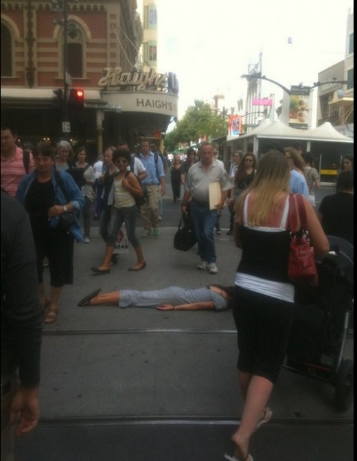 Planking on a pedestrian walkway
