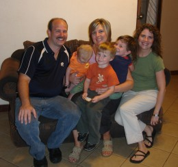 Jason Tressa and their three young children.  Michelle from our team is in the middle.