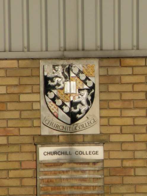 College arms at Churchill College's and King's College's boathouse