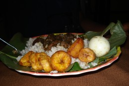 Ofada Rice served with dodo (Fried palntain) and boiled egg.