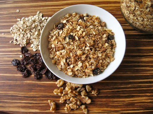 Oven baked granola contains old-fashioned rolled oats, dried cherries, and walnuts....but no butter or oils!