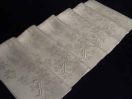 Monogrammed antique linen napkins laundered at home and ready to use.