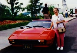 My mother standing next to Yakov's Ferrari parked just outside the theatre.