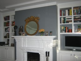 Any wall with a fireplace is a natural for a bold, accent color
