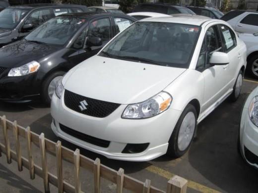 Maruti SX4 pearl white 2008 model.